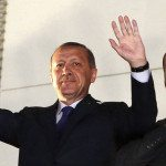 Turkish Prime Minister Tayyip Erdogan, accompanied by his son Bilal and daughter Sumeyye, greets his supporters in Ankara