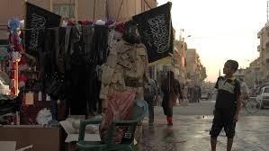 bendera isis di raqqa