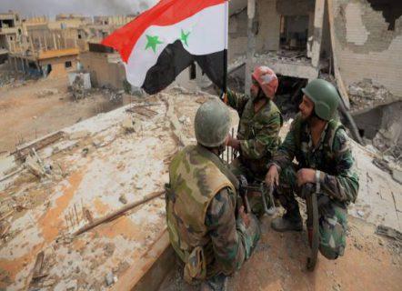 tentara suriah kibarkan bendera